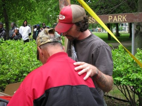 Jeremy Roth praying with man at Cass Park