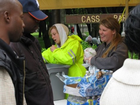 Leah Ostrander & Christi Roth hand out water and essentials